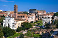 Roman forum in rome italy image with ruins of ancient and coliseum colosseum from empire civilization Royalty Free Stock Photos