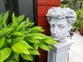 Roman Head Statue In Garden