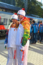 Roman Kostomarov and Tatiana Navka at the Olympic torch relay Stock Image