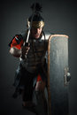 Roman legionary with sword and shield in the attack Royalty Free Stock Photo