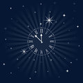 Roman numeral clock getting close to midnight over a starry night sky Stock Photos