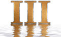 Roman numeral III, tres, 3, three, reflected on the water surfac Royalty Free Stock Photo