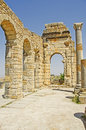 Roman ruins a scene from the basilica within the remains of the city of volubilis in morocco north africa Royalty Free Stock Photo