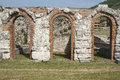 Roman ruins triple arch left standing near italian village of gubbio Stock Images