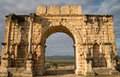 Roman ruins in volubilis main gate of city Stock Photo