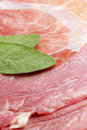 Roman saltimbocca slices of veal with italian ham and sage leaves Stock Photo