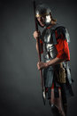 Roman soldier in armor with a spear in hand Royalty Free Stock Photo