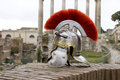 Roman soldier helmet in front of ancient roman ruins the fori imperiali rome italy Stock Photos
