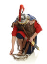Roman soldier picking up a crown of thorns Royalty Free Stock Photo