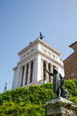 Roman statues plaza with statue and rooftop statue in background Stock Photo