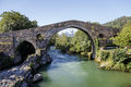 Roman stone bridge in cangas de onis old spain Royalty Free Stock Photo