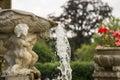Roman style fountain old statue in a garden Stock Photos