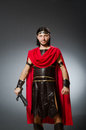 The roman warrior with sword against background