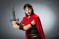 The roman warrior with sword against background Royalty Free Stock Photo