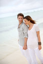 Romance by the beach romantic couple walking on Stock Images