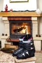 Boots ski boots in front of  fireplace Royalty Free Stock Photo