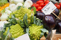 Romanesco and eggplant at market fresh onions tomatoes an italian vegetable Stock Images