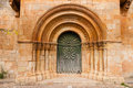 Romanesque portal of moarves de ojeda church with fine archivolts and beautiful door the in a small village called in the povince Stock Images