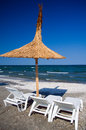 Romania black sea umbrella and sunbeds at the in mamaia Royalty Free Stock Image