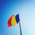 Romania flag waving over blue sky Stock Photo