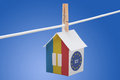 Romania romanian and eu flag on paper house concept painted a hanging a rope Stock Photography