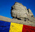 Romania the sphinx from the bucegi mountains and the romanian national flag a symbol megalithic monument Stock Photo