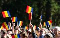 Romanian crowd waving flags the public is greeting the royal family at elisabeta palace in bucharest romania during the open doors Royalty Free Stock Photography