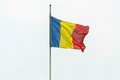 Romanian flag the on blue sky Royalty Free Stock Photos