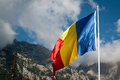 Romanian flag and the carpathians waving next to Royalty Free Stock Photography