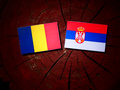 Romanian flag with Serbian flag on a tree stump Royalty Free Stock Photo