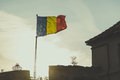 Romanian flag is waving with sunset in background Royalty Free Stock Photo