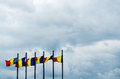 Romanian flags on a stormy sky Royalty Free Stock Photography