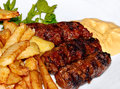 Romania Traditional Meatballs Or Mici And Fried Chips Royalty Free Stock Photo