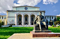 Romanian national opera the and the statue of george enescu in bucharest romania Royalty Free Stock Image