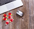 Romanic flower pedals on rustic work desktop Royalty Free Stock Photo