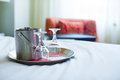 Romantic bedroom with wine glasses and ice bucket in luxury hotel interior Royalty Free Stock Photo