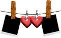 Romantic blank photos hanging on rope two and two red wooden hearts a steel cable with large clothespin Stock Photo