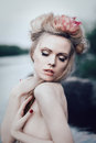 Romantic blond woman art fashion portrait of young with closed eyes in water Royalty Free Stock Images