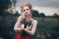 Romantic blond woman art fashion portrait of young girl with flowers in hair on meadow Royalty Free Stock Photography