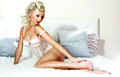Romantic blonde woman posing in bed Royalty Free Stock Photo