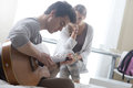 Romantic boy playing guitar for her girlfriend young handsome men his Stock Photo