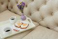 Romantic breakfast with bouquet on couch Royalty Free Stock Photo
