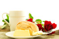 Romantic breakfast with flowers bread butter and roses on wooden table composition Stock Image