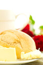 Romantic breakfast with flowers macro bread butter and roses on wooden table composition Stock Photo