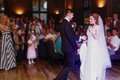Romantic bride and groom dancing and holding hands at wedding re Royalty Free Stock Photo