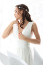 Romantic bride in a white dress in a scenery Royalty Free Stock Photo