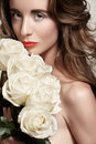 Romantic bride with white roses volume hair luxury woman natural fashion makeup glossy coral lips strong eyebrows clean face look Royalty Free Stock Image