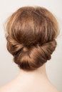 Romantic bun rear view of the head of a young redhead woman with a Royalty Free Stock Photos
