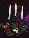 Romantic composition with candles still life rose and vampire killing objects Stock Photos
