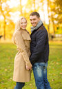 Romantic couple in the autumn park holidays love travel tourism relationship and dating concept Royalty Free Stock Photography